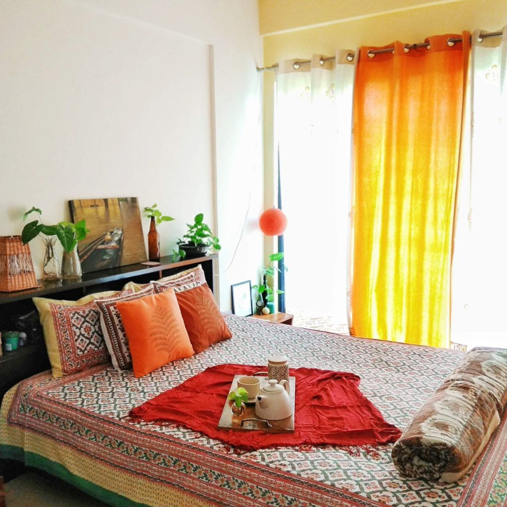 Jayati and Manali share their home tour as the science home décor - the headboard space fill with lamp, frame and green plants