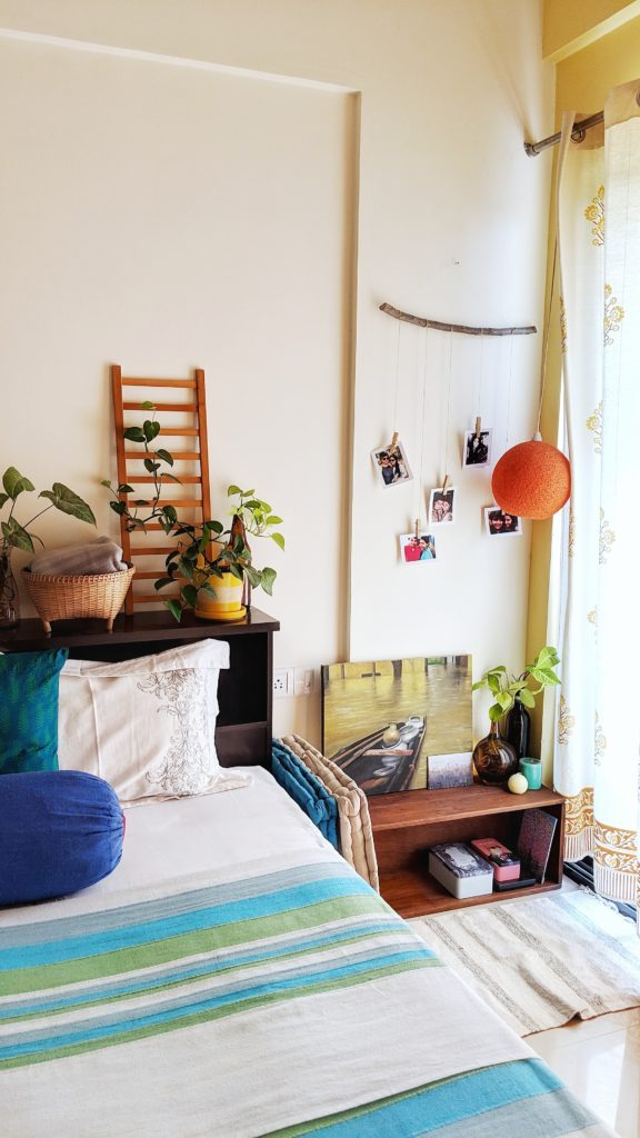 Jayati and Manali share their home tour as the science home décor - the bedroom is decorated with beautiful photos, hanging light, green plants, ladder and handpainted frame