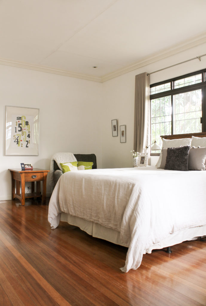 Home Tour with Kaho of Chuzai Living - the master bedroom filled with photo frame, sofa chair, table and table lamp