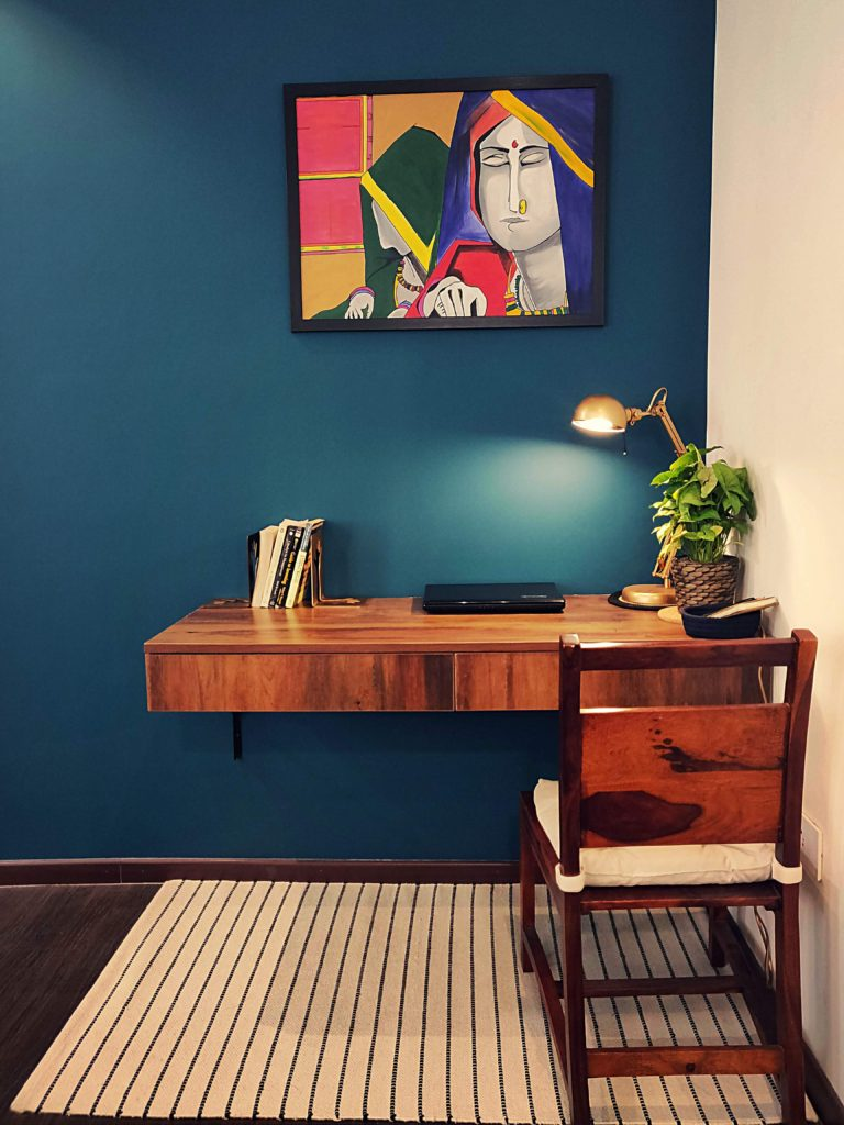 Home style Tour with Rajni in Hyderabad: handpainted frame, table lamp, green plants and books on the study desk