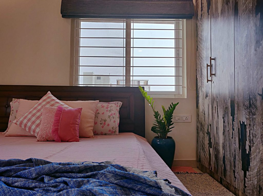 Home style Tour with Rajni in Hyderabad: the collection of pink cushion and green plants make the bedroom simple and beautiful