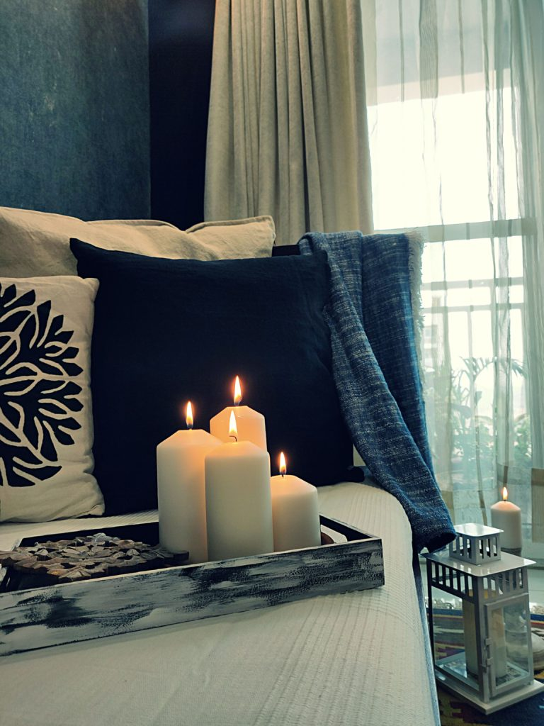 Home style Tour with Rajni in Hyderabad: the collection of candles and the beautiful cushion cover makes the room perfect