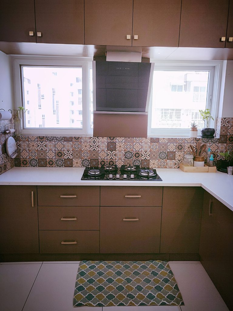 Home style Tour with Rajni in Hyderabad: The tiles used for backsplash are Morrocan to add an element of interest in a brown and beige kitchen