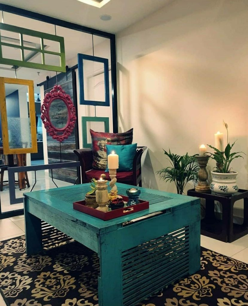 Home style Tour with Rajni in Hyderabad: The teal blue center table was made from an old teak door and given a distressed look
