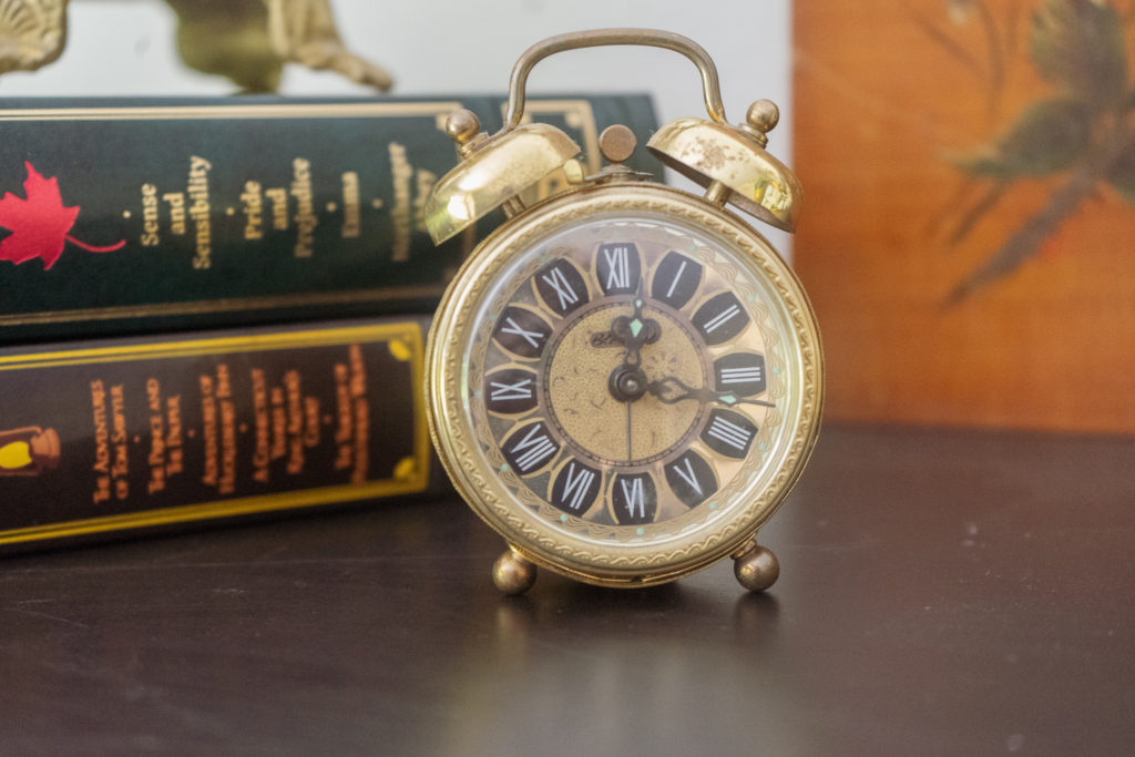 Affinity for antiques and collection of vintage | Home tour of Rushika & Dipkal's - A beautiful collection of antique clock and books