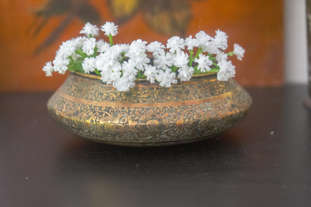 Affinity for antiques and collection of vintage | Home tour of Rushika & Dipkal's - brass bowl with flower on it