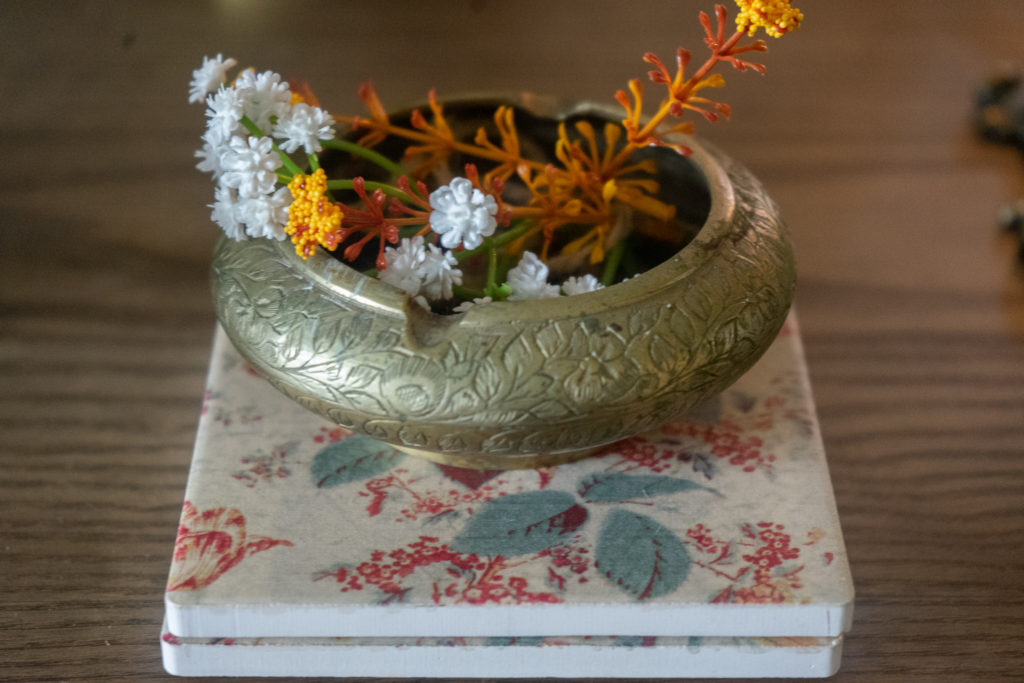 Affinity for antiques and collection of vintage | Home tour of Rushika & Dipkal's - the brass bowl is filled with flower