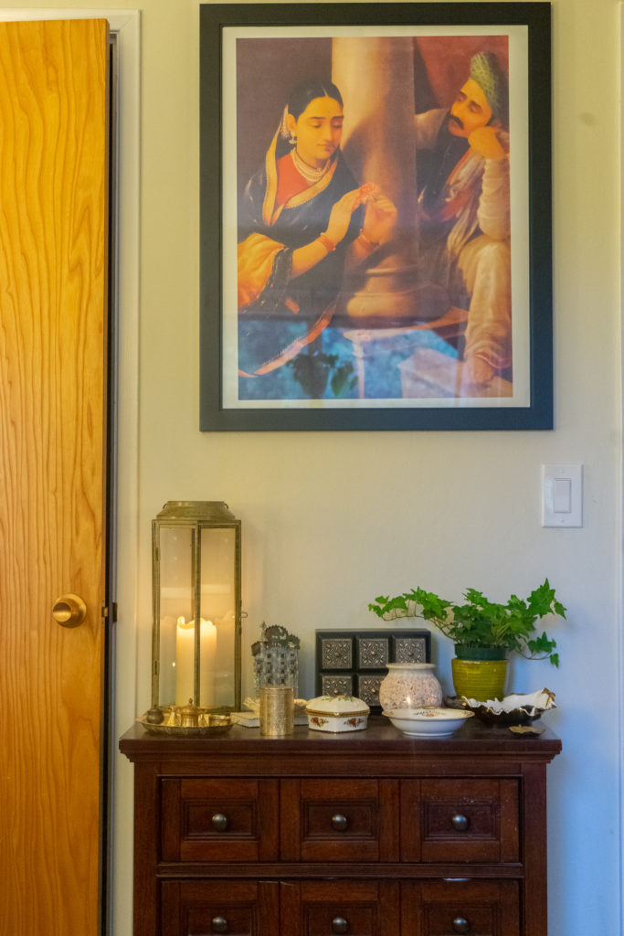 Affinity for antiques and collection of vintage | Home tour of Rushika & Dipkal's - the beautiful painting and the antiques collection of brass and bronze decor, candle stands and lanterns at the corner of the room