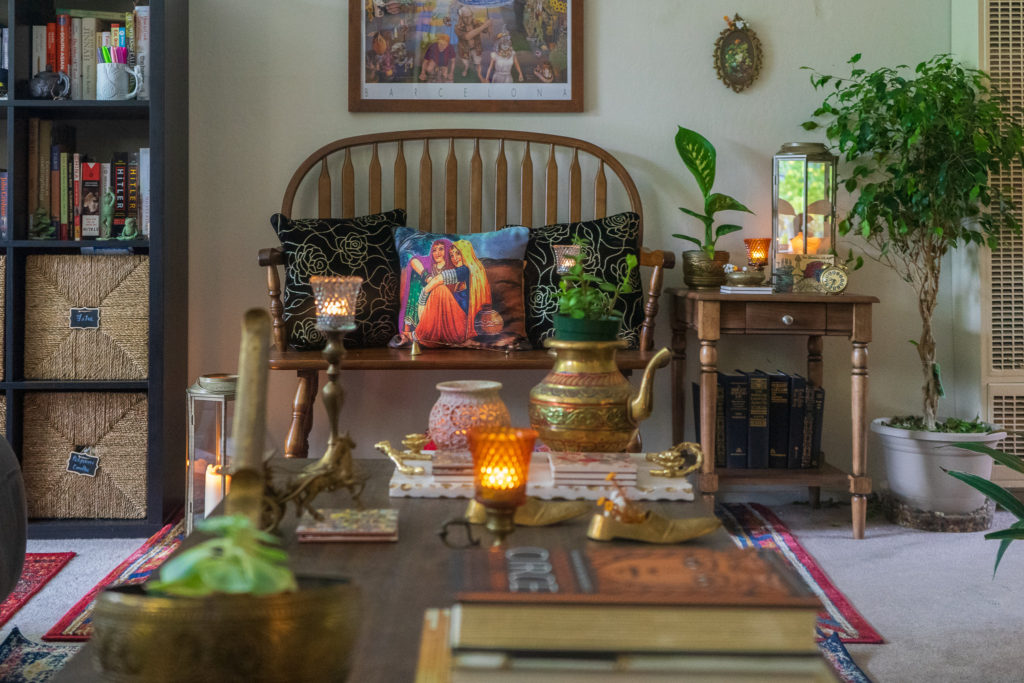Affinity for antiques and collection of vintage | Home tour of Rushika & Dipkal's - the beautiful collection of brass decor, candle stands, lanterns and oil painting at the sitting room