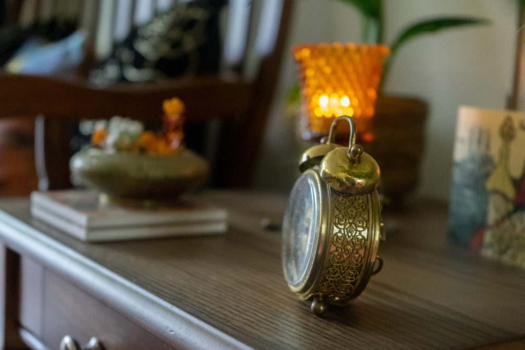 Affinity for antiques and collection of vintage | Home tour of Rushika & Dipkal's - the antique clock at the corner of the room