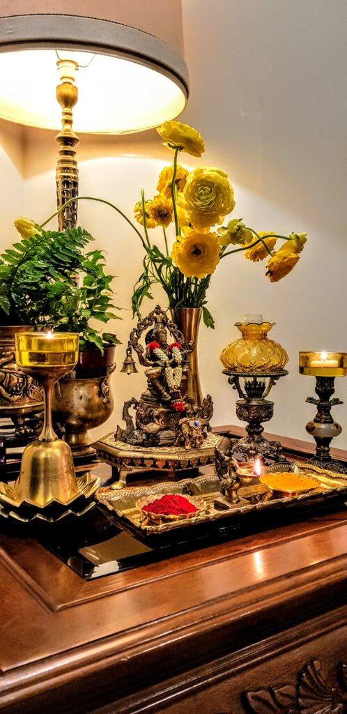 The metals compliment each other and work together with the diyas, flowers to add depth and enhance the beauty of the colorful festival