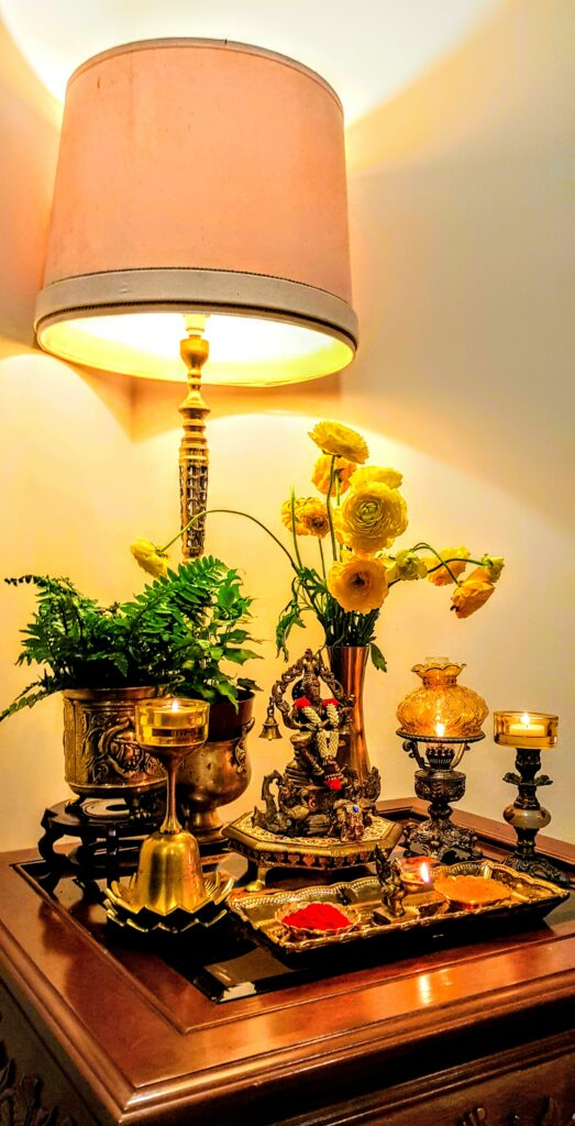The metals compliment each other and work together with the diyas, flowers to add depth and enhance the beauty of the colourful festival