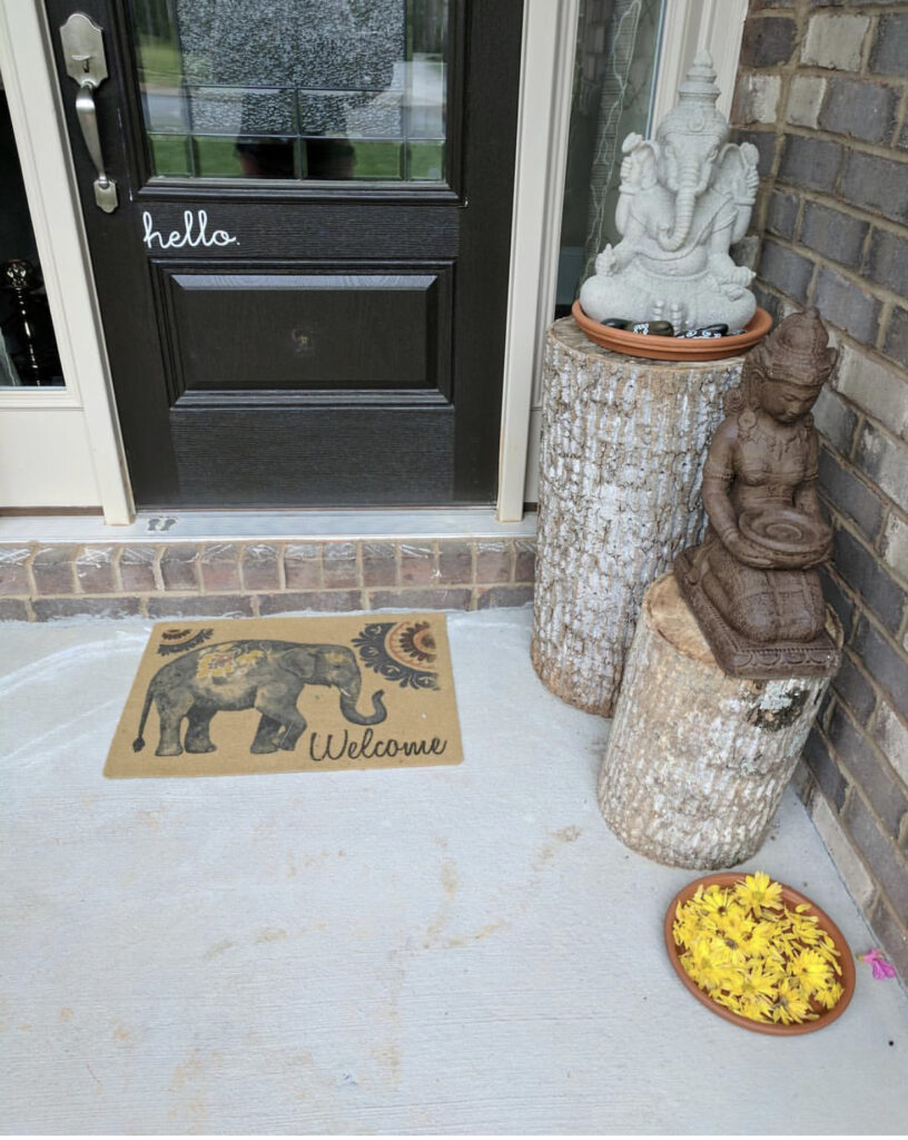 Welcome home by placing a statue in front door