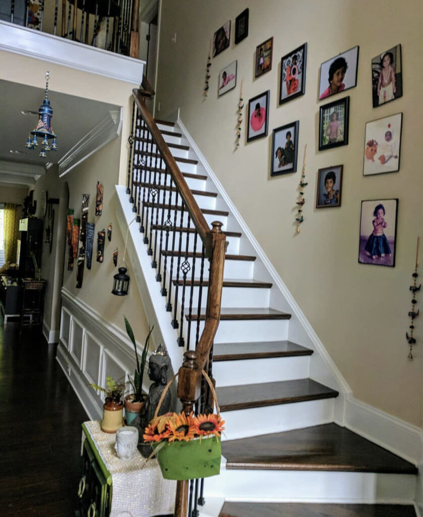 The staircase is decorated with photo gallery on the wall