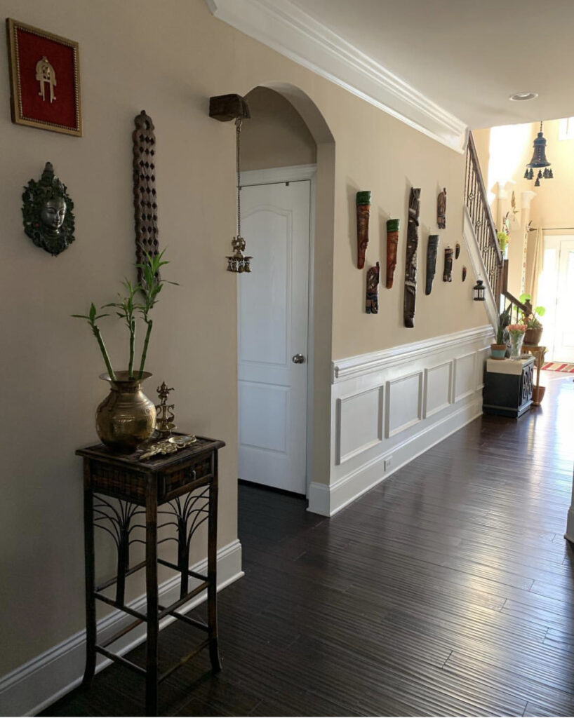 The home is filled with brass idols and mask collection