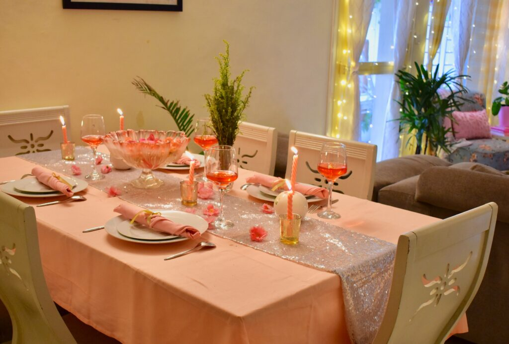 The dining room is decorated with pink color - babies, blushes, roses, sakura, cotton candy all wear pink