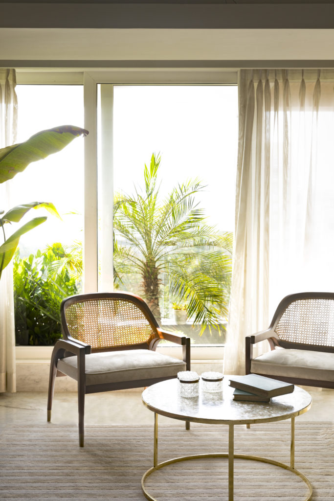 Home Renovation Story | Mohamedi & Durriya Sham's Aesthetic Mumbai Home - tall tropical plants for the outside balcony