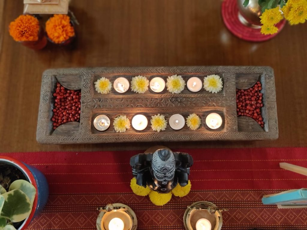 Wooden diya stand for diwali decoration at the living room table
