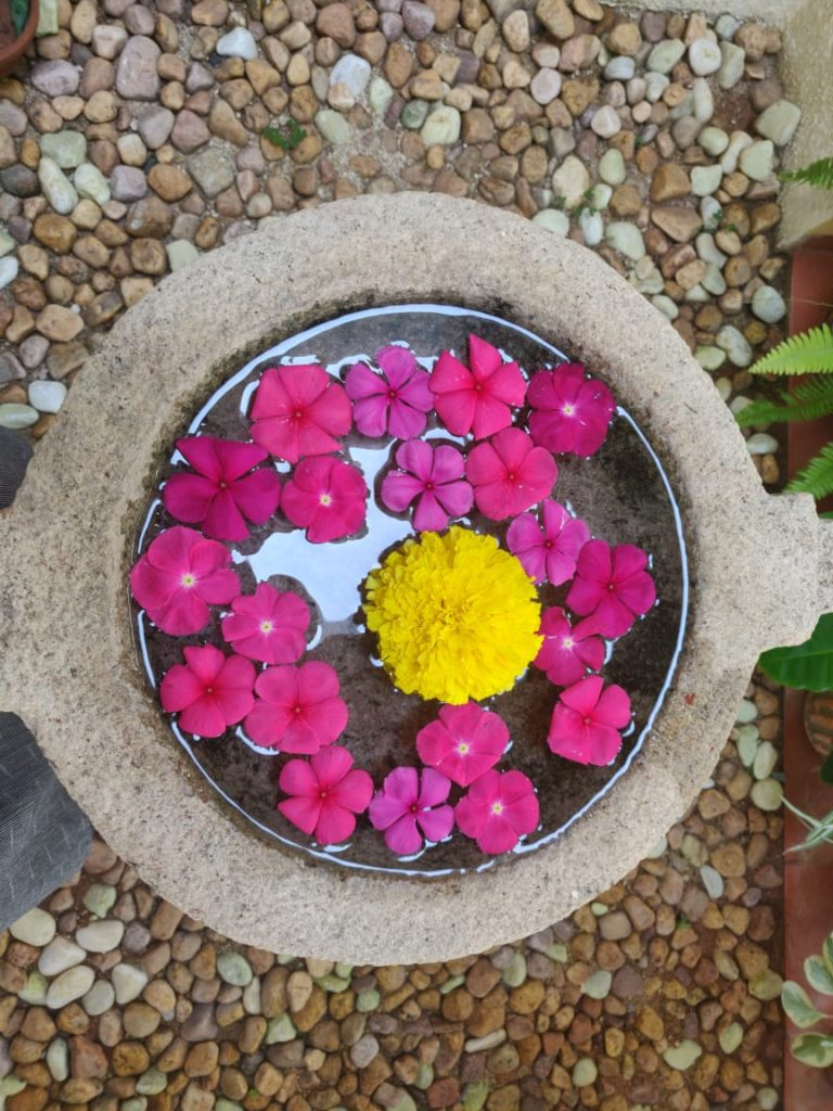 Fresh flower rangoli at the corner of the garden