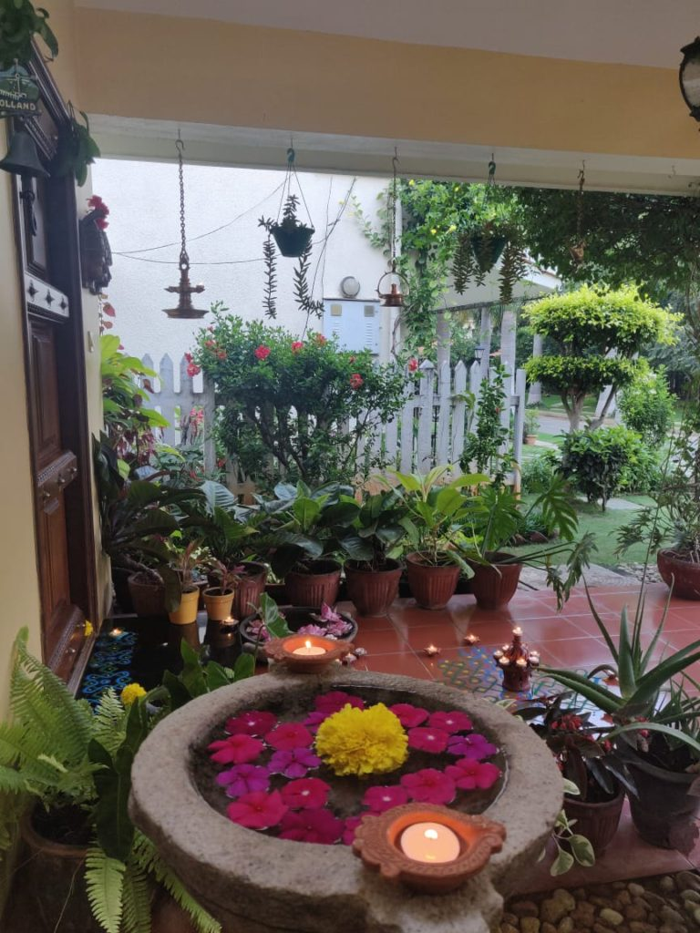 the front door entry is decorated with rangoli and surrounded by diyas for diwali festival celebration