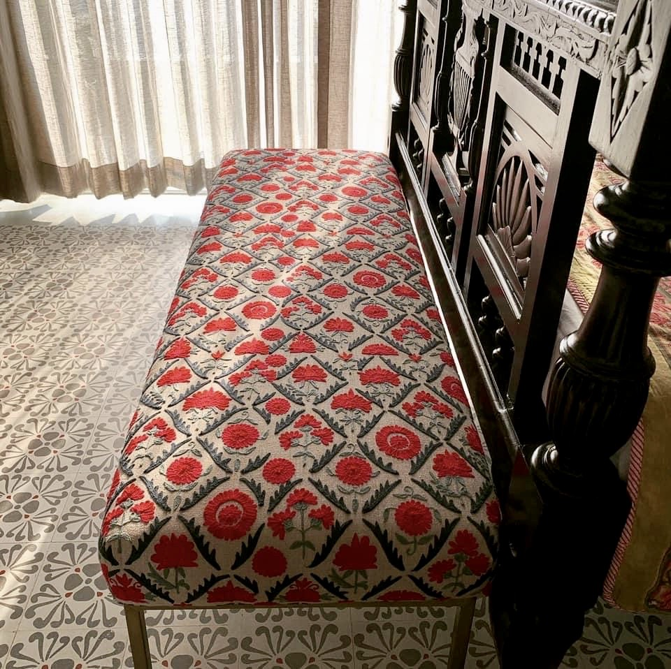 The pretty bed seating - metal legs, and a lovely traditional fabric, against lovely old tiles and carved bed frame | Vintage Modern Indian decor | theKeybunch decor