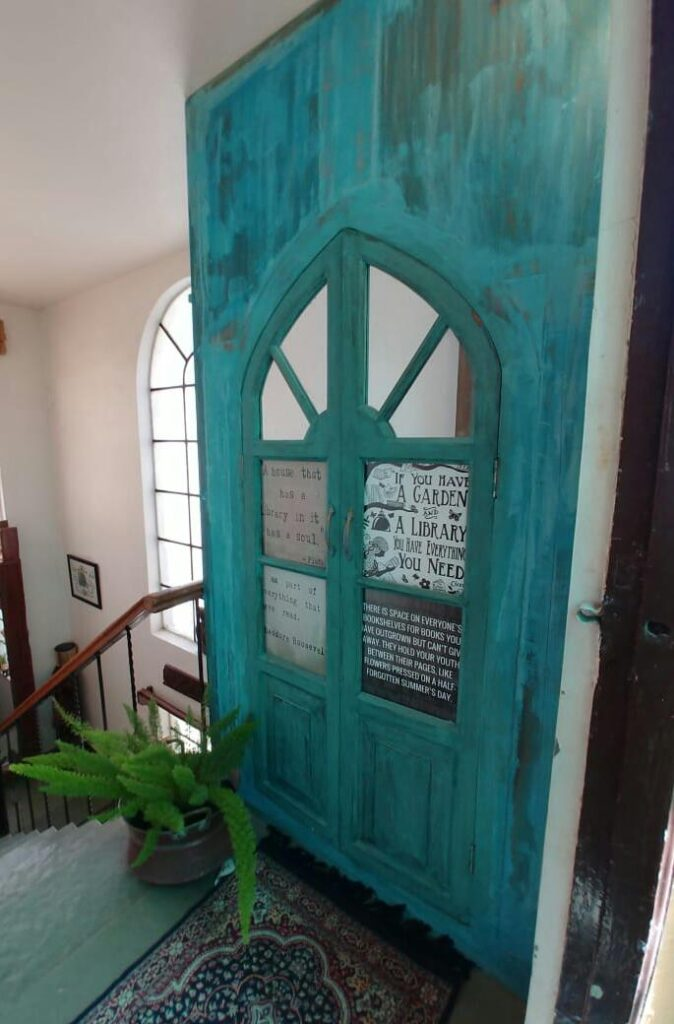 An old church door into a gorgeous library door | Vintage Modern Indian decor | theKeybunch decor