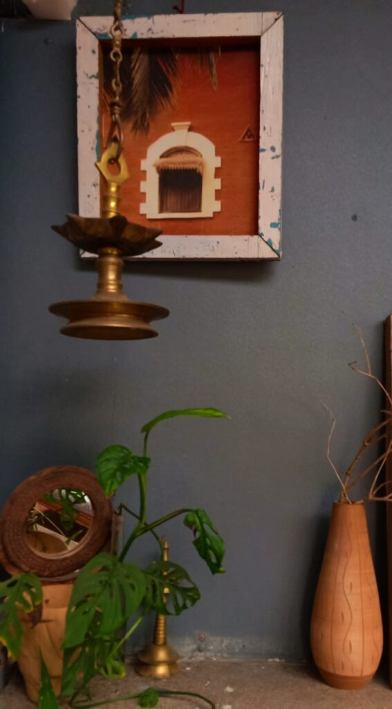 Antique brass diya and green plant at the corner of the room | Leesha's Pune home tour | Thekeybunch