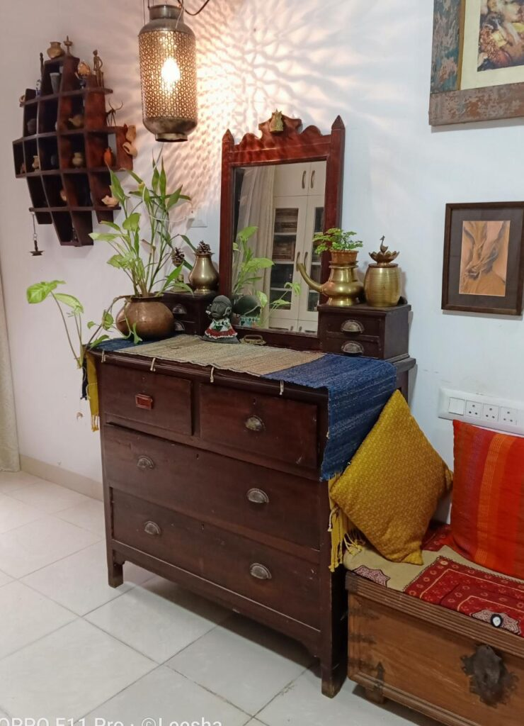 Lit lamps and warm colours, beautiful antiques at the living space area | Leesha's Pune home | Thekeybunch
