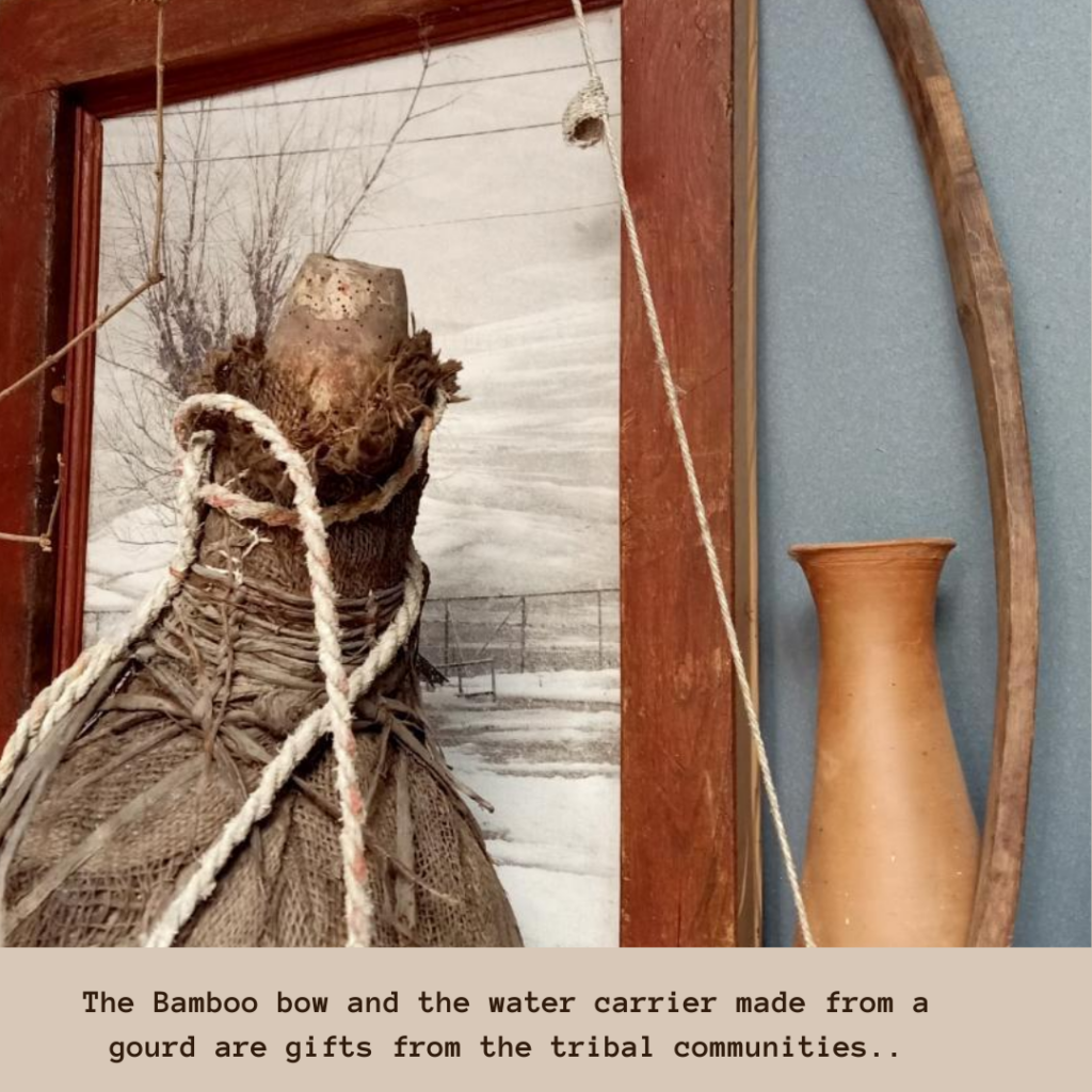 The bamboo bow and the water carrier made from a gourd gifted by tribal communities | Leesha's Pune home | Thekeybunch