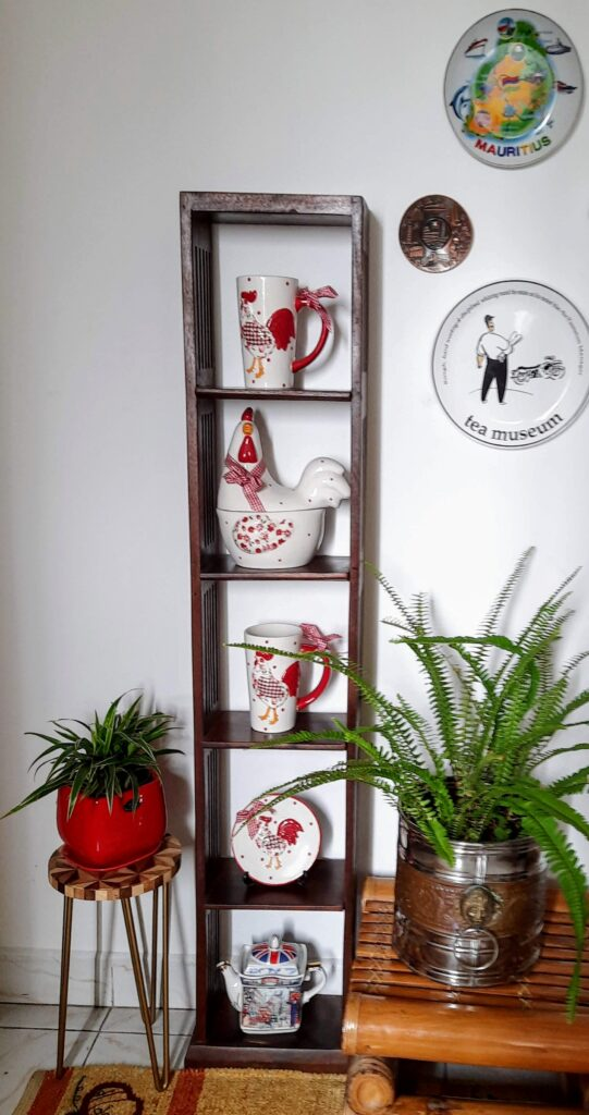Russian ceramic potteries, green plants and wall frame at the corner of the room | Upasana Talukdar home tour | theKeybunch decor