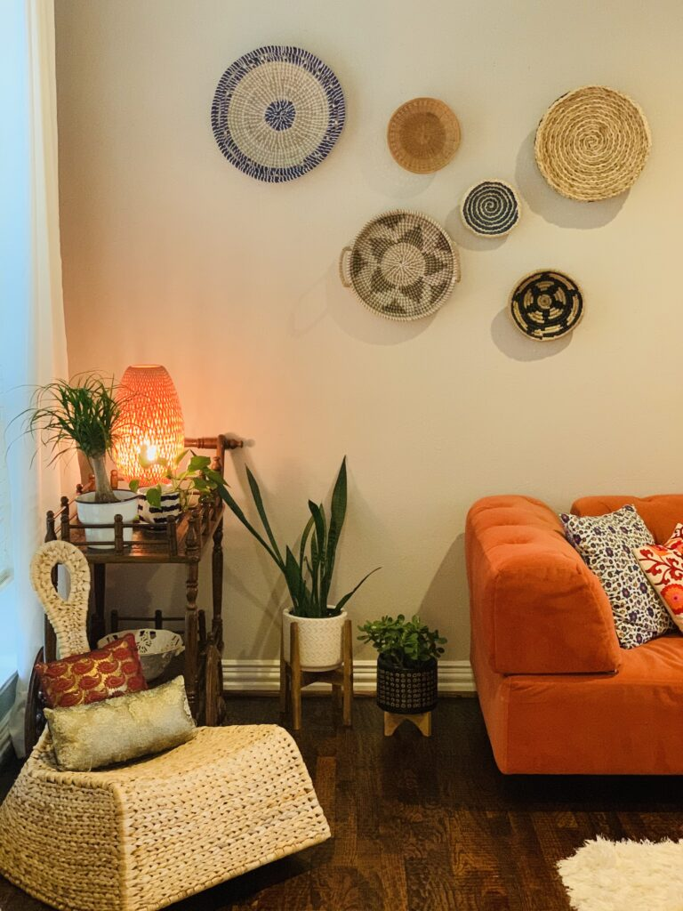 orange sets off the drama on the walls beautifully | Ruma's Indian Home in Texas | theKeybunch decor blog