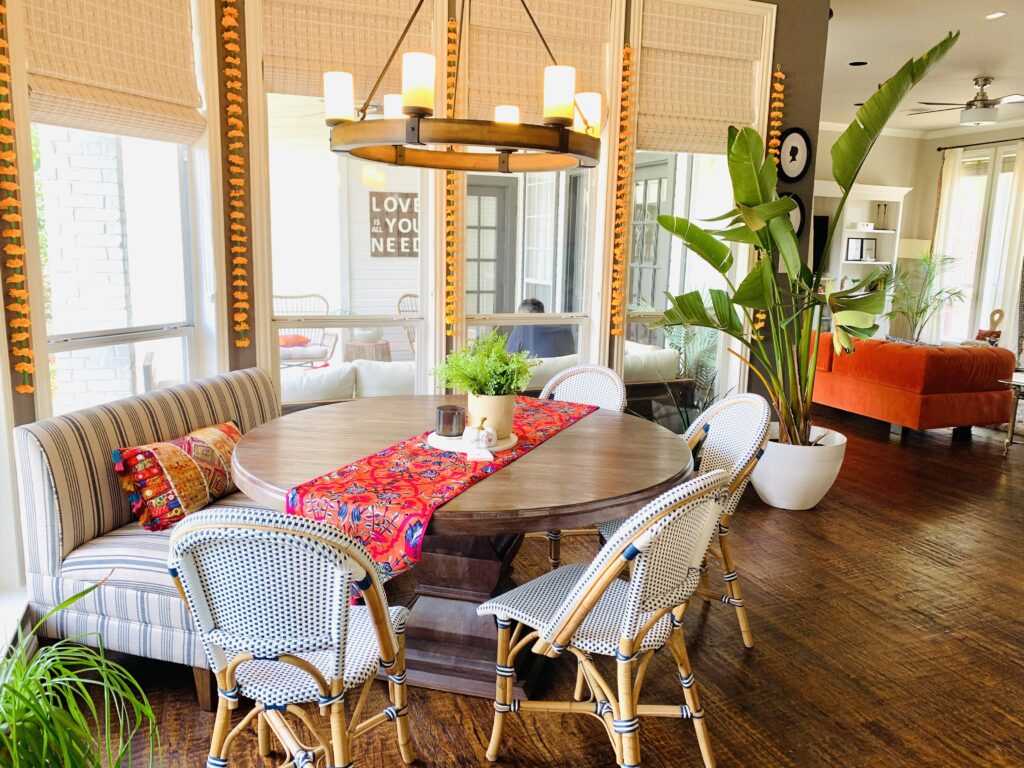 The breakfast nook is decorated with marigolds last week diwali and bird of paradise from the backyard porch | Ruma's Indian Home in Texas | theKeybunch decor blog