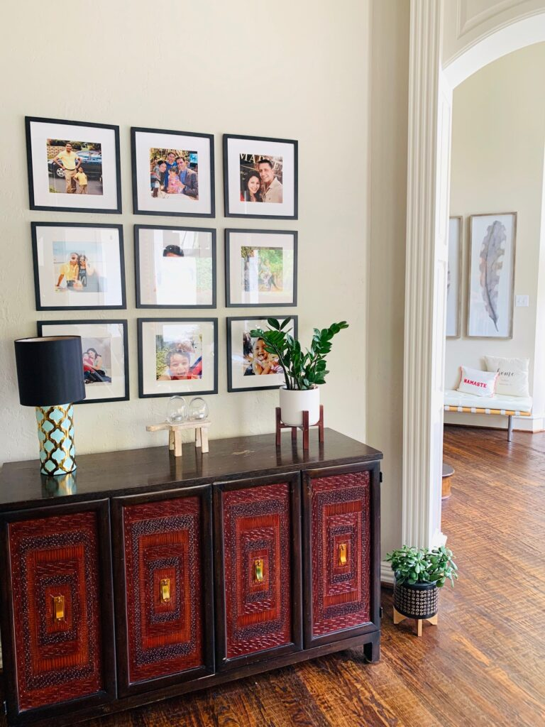the wall gallery, green plants and chest drawer at the corner of the room | Ruma's Indian Home in Texas | theKeybunch decor blog