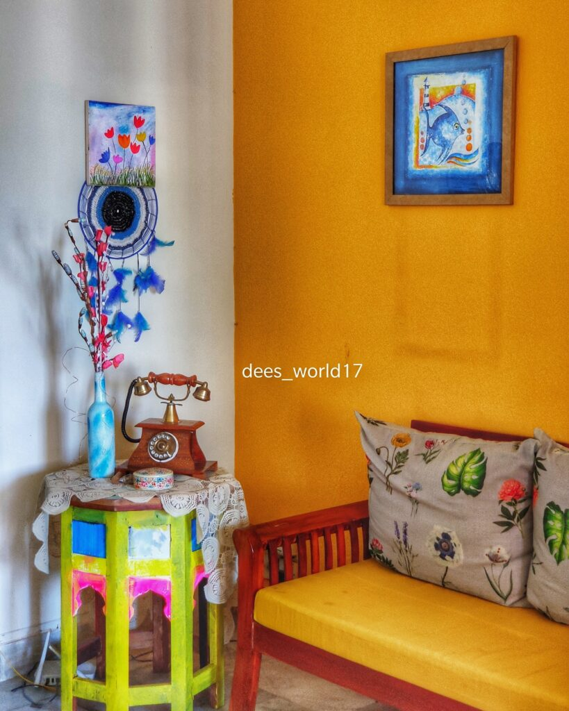 The corner of the room is decorated with old yellow tables, that have been given a new lease of life, with bright colours and artwork | Dharitri home tour | thekeybunch decor