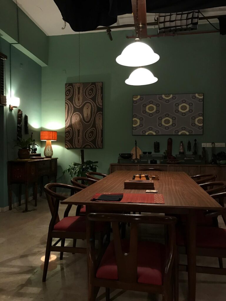 The dining furniture was designed and built as well and the partitions along with the extension in the kitchen re-upholstered - 'Sir' Indian Movie set | theKeybunch decor blog