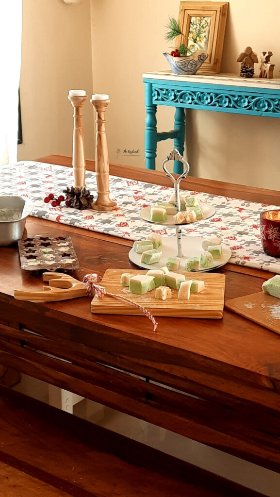 The dining table is setting up with table runner, decorative candle stands, vintage cake stand, voltive and chopping cheese board | Areas where an Interior Stylist can help you | Thekeybunch decor blog