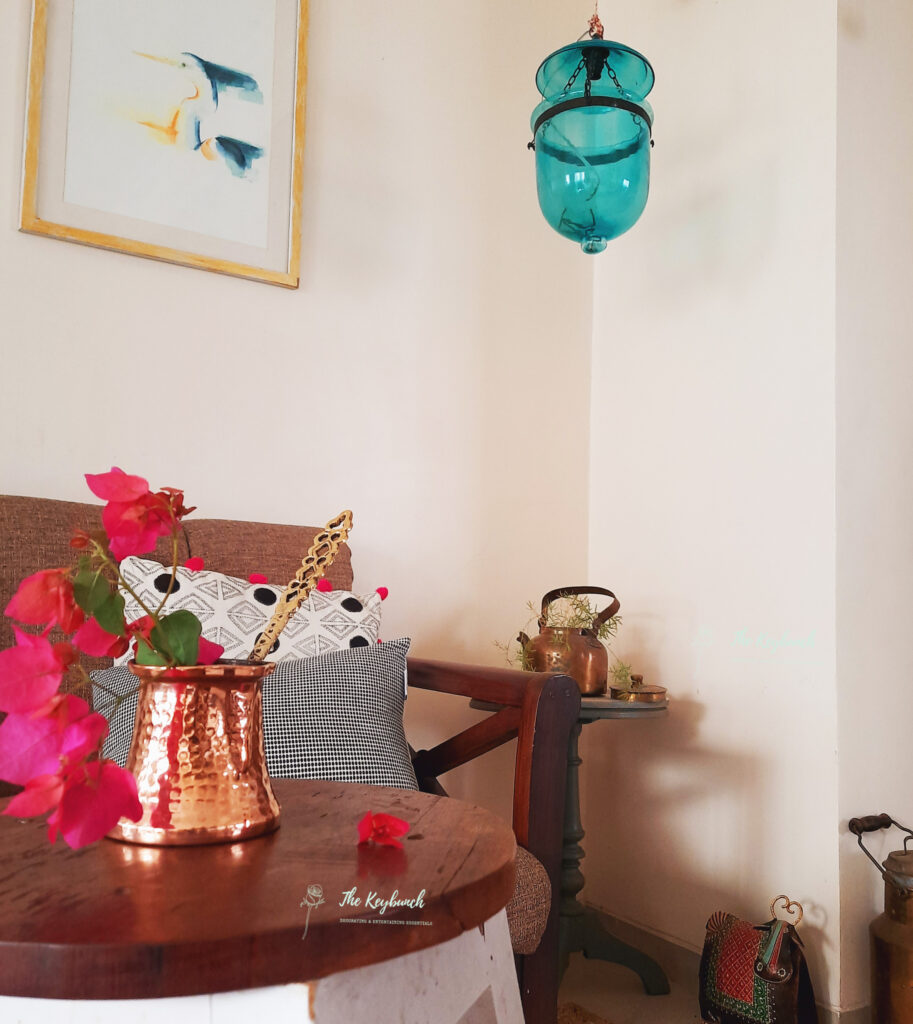 A copper vase filled with a pretty bunch of bougainvillea, on the table at the living room | Areas where an Interior Stylist can help you | Thekeybunch decor blog