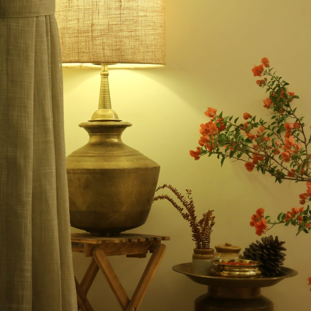 The ikea table, jute lampshade, fern fronds are all fairly contemporary and the brass elements are traditional. The bougainvillea is in bloom | Home Tour: A beautiful Antique Modern home in Bangalore