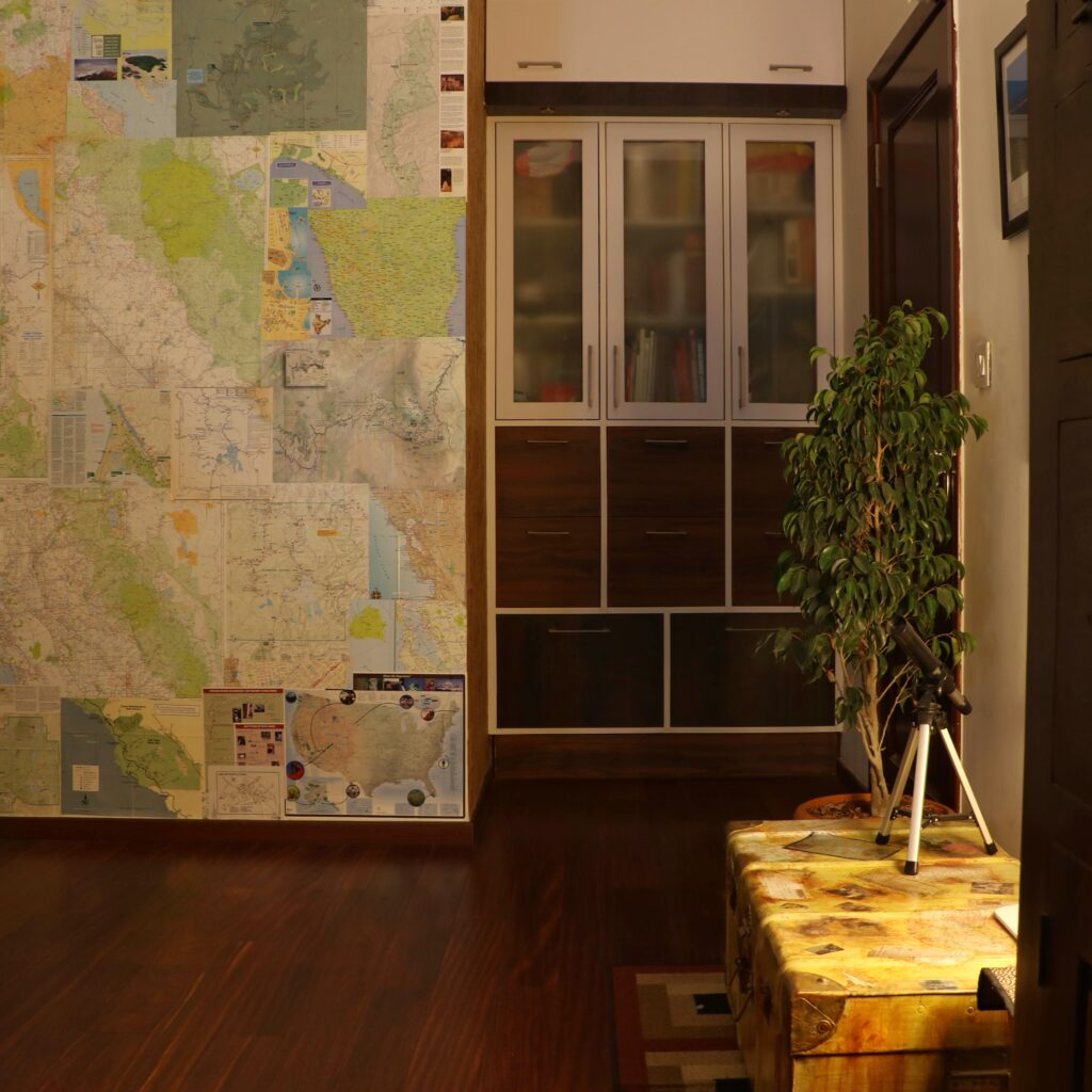 The map wallpaper at the nook behind the door in the study room | Home Tour: A beautiful Antique Modern home in Bangalore