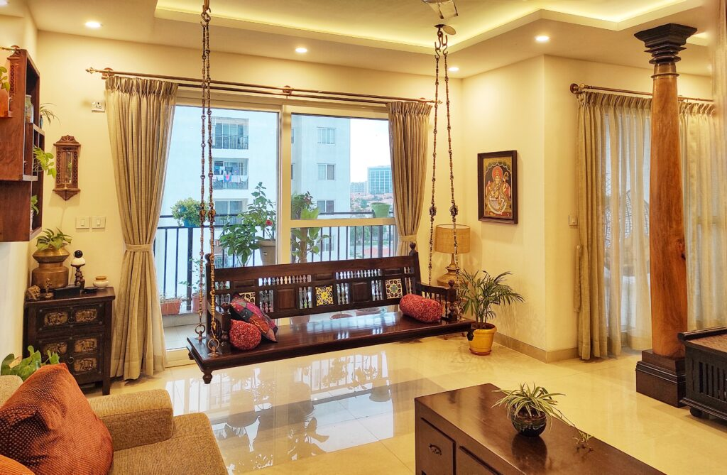 Traditional jhoola swing in living room | Home Tour: A beautiful Antique Modern home in Bangalore