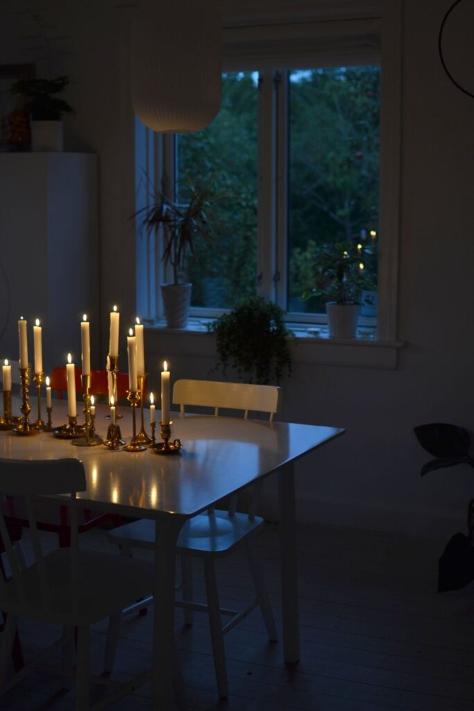 Lighting candles on the dining table | Naina's Scandi-Minimalist Home with Indian Accents