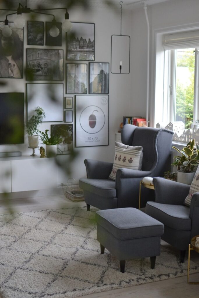 The beautiful frame of candle light hanging in a metal rectangle, grey chair and gallery wall | Naina's Scandi-Minimalist Home with Indian Accents