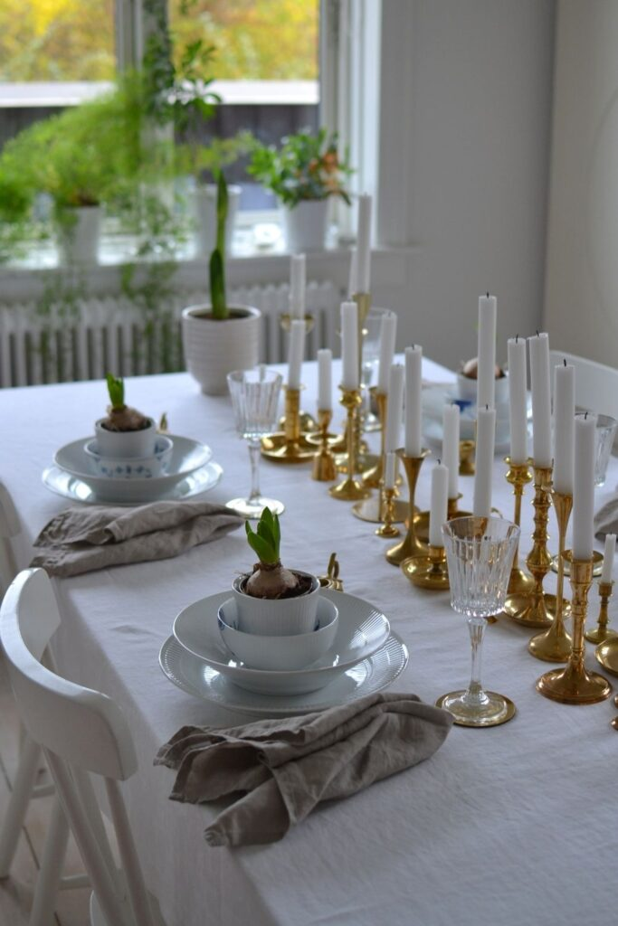The beautiful candle holder collection at the dining table | Naina's Scandi-Minimalist Home with Indian Accents