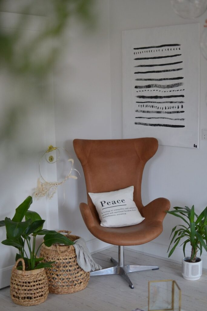 The chair and the basket planters at the corner of the room | Naina's Scandi-Minimalist Home with Indian Accents