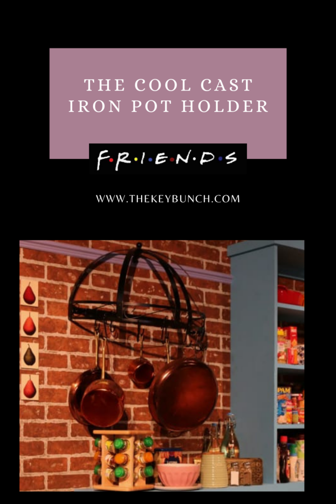 The cool cast iron pot holder and the copper pans hanging on the wall | DECOR ELEMENTS FROM THE SET THAT ARE COOL EVEN TODAY | theKeybunch decor blog