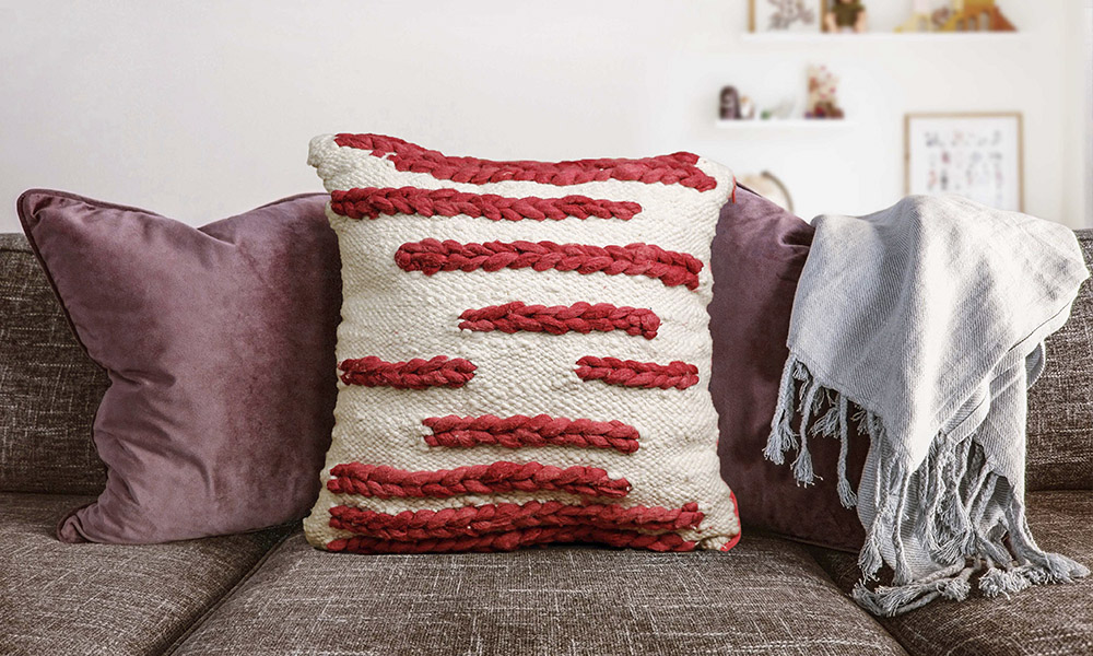 A throw alongside a woven cushion cover, made on the home tapestry loom | 6 Tapestry DIYs on Muezart's home-use loom