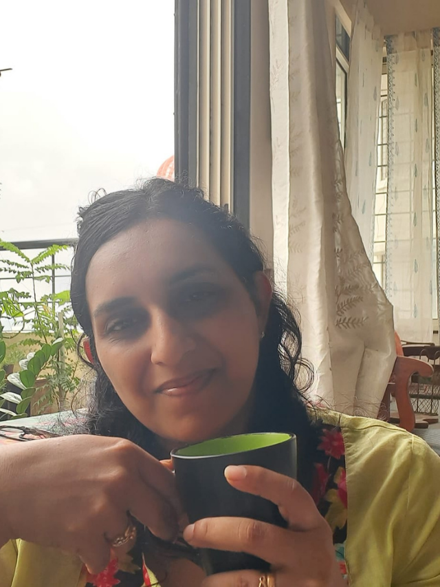 Sharon Dsouza with a cup of coffee Monoon decor and living edit