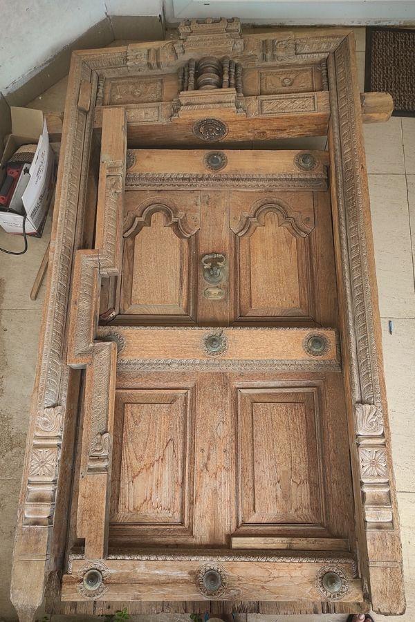 vintage teak wood door | Home Tour: A beautiful Antique Modern home in Bangalore