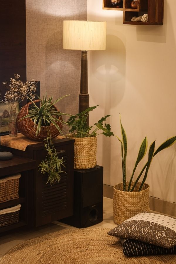 The two rivergrass baskets and a floor lamp made out of shell casings | Home Tour: A beautiful Antique Modern home in Bangalore