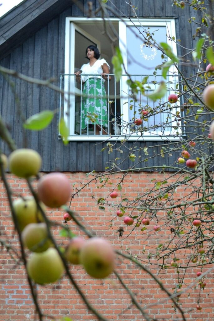 The beautiful shot of Naina and apple trees from her garden | Naina's Scandi-Minimalist Home with Indian Accents